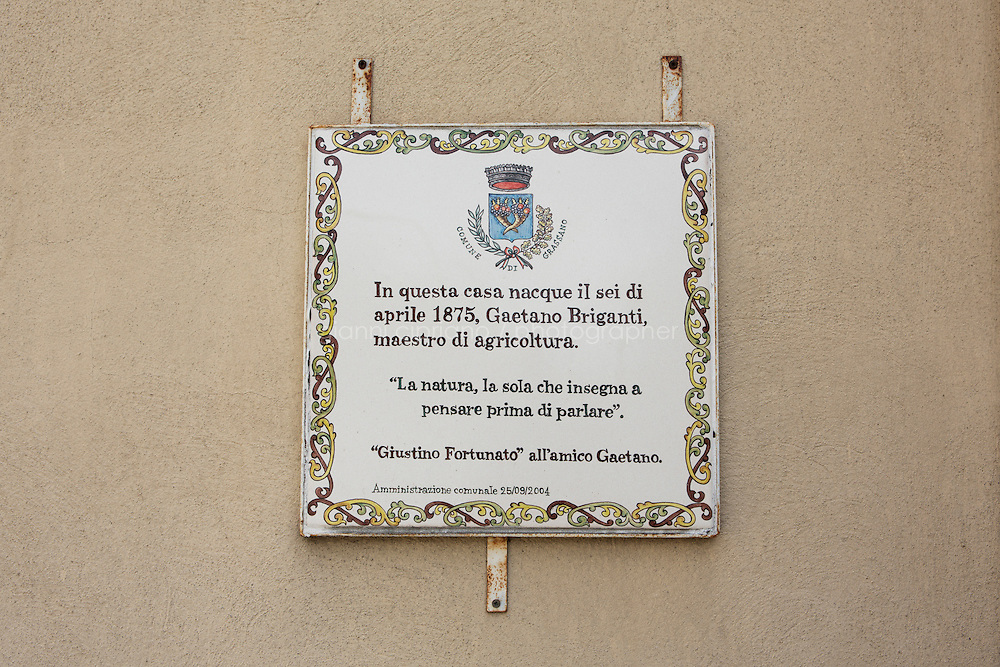 GRASSANO, ITALY - 24 JULY 2014: A commemorative plaque for Gaetano Briganti for being a master of agriculture, is here at the entrance of the house where he grew up with his sister Anna Briganti (Mayor of New York Bil de Blasio's grandmother)  in Grassano, Mr de Blasio's ancestral home town in Italy, on July 24th 2014.<br /> <br /> New York City Mayor Bill de Blasio arrived in Italy with his family Sunday morning for an 8-day summer vacation that includes meetings with government officials and sightseeing in his ancestral homeland.