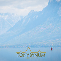 lake mcdonald lone kayaker on calm lake glacier national park