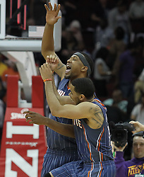 Apr 11; Newark, NJ, USA; Charlotte Bobcats point guard D.J. Augustin (14) and Charlotte Bobcats center Kwame Brown (54) celebrate Augustin's game-winning basket during the second half at the Prudential Center. The Bobcats defeated the Nets 105-103.
