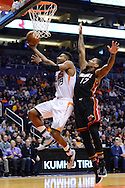 Jan 3, 2017; Phoenix, AZ, USA;  Phoenix Suns guard Leandro Barbosa (19) lays up the ball in front of Miami Heat guard Rodney McGruder (17) in the first half of the NBA game at Talking Stick Resort Arena. Mandatory Credit: Jennifer Stewart-USA TODAY Sports
