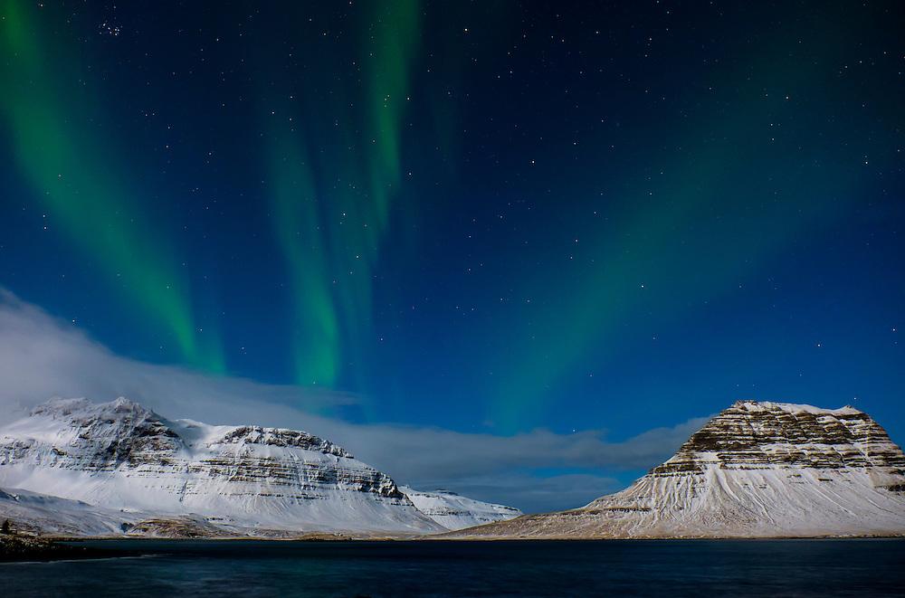 GRUNDARFJOROUR, ICELAND - CIRCA MARCH 2015: Aurora Borealis, also known as Northern Lights over the Kirkjufell mountain near Grundarfjordur, a landmark in the Snaefellsness Peninsula.