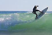 Surfer Riding the Lip, Sandy Bay, New Zealand