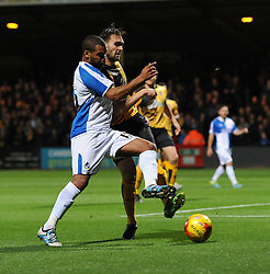 Jermaine Easter of Bristol Rovers challenges for the ball with Greg Taylor of Cambridge United - Mandatory byline: Dougie Allward/JMP - 07966 386802 - 30/10/2015 - FOOTBALL - The Abbey Stadium - Cambridge, England - Cambridge United v Bristol Rovers - Sky Bet League Two