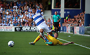 Massimo Luongo (QPR midfielder) getting fouled by Richard Smallwood (Rotherham midfielder) during the Sky Bet Championship match between Queens Park Rangers and Rotherham United at the Loftus Road Stadium, London, England on 22 August 2015. Photo by Matthew Redman.