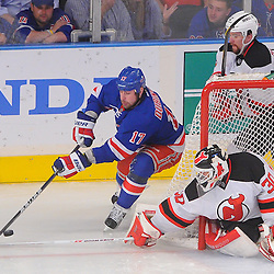 May 23, 2012: New Jersey Devils goalie Martin Brodeur (30) pokes away New York Rangers left wing Brandon Dubinsky's (17) wraparound attempt during third period action in game 5 of the NHL Eastern Conference Finals between the New Jersey Devils and New York Rangers at Madison Square Garden in New York, N.Y.