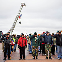Veterans salute the flag during the Pledge of Allegiance in the McKinley Courthouse Square Plaza, Monday Nov. 12, in Gallup at the Veterans Day Celebration.
