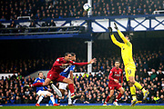 Liverpool defender Joel Matip (32) and Liverpool goalkeeper Alisson Becker (13) deal with the danger from Everton forward Dominic Calvert-Lewin (29) during the Premier League match between Everton and Liverpool at Goodison Park, Liverpool, England on 3 March 2019.