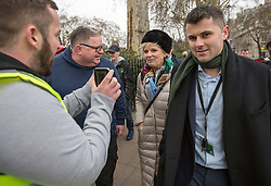 © Licensed to London News Pictures. 07/01/2019. London, UK. Conservative MP and Remain campaigner ANNA SOUBRY is heckled by a group of Brexit supporters, including JAMES GODDARD (left, back to camera) as she returns to the Houses of Parliament in London after appearing on broadcast television programs on College Green, Westminster. Photo credit:  George Cracknell/LNP