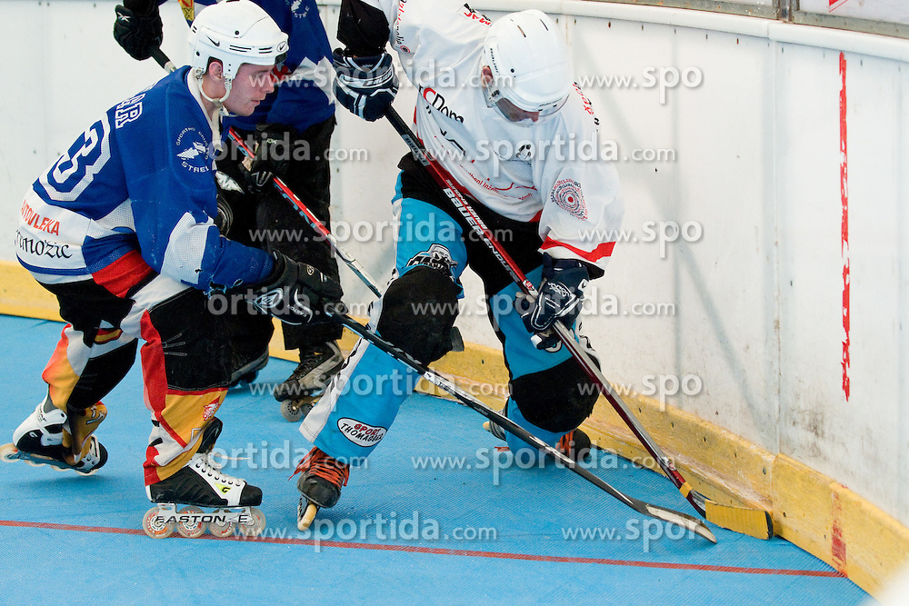 Nejc Sotlar of Citypark Strele and Luka Mubi of DPH Kavke Kranj at IZS Masters 2010 inline hockey match between Citypark Strele and DPH Kavke Kranj, on June 12, 2010, in Ice Hall, Kranj, Slovenia. (Photo by Matic Klansek Velej / Sportida)