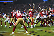 San Francisco 49ers defensive end Solomon Thomas (94), 49ers defensive tackle Earl Mitchell (90), and 49ers defensive tackle DeForest Buckner (99) try to block a second quarter field goal by the New York Giants that ties the game at 10-10 during the NFL week 10 regular season football game against the New York Giants on Monday, Nov. 12, 2018 in Santa Clara, Calif. The Giants won the game 27-23. (©Paul Anthony Spinelli)