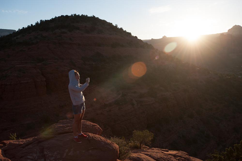 Tourist taking Picture of sunrise in Sedona AZ