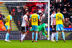 The ball goes past Marek Rodak of Rotherham United to extend Sheffield United's lead - Mandatory by-line: Ryan Crockett/JMP - 09/03/2019 - FOOTBALL - Bramall Lane - Sheffield, England - Sheffield United v Rotherham United - Sky Bet Championship