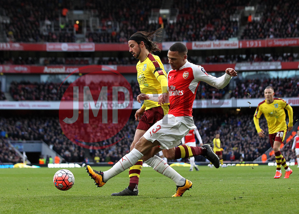Kieran Gibbs of Arsenal crosses the ball while under pressure from George Boyd of Burnley - Mandatory byline: Robbie Stephenson/JMP - 30/01/2016 - FOOTBALL - Emirates Stadium - London, England - Arsenal v Burnley - FA Cup Forth Round