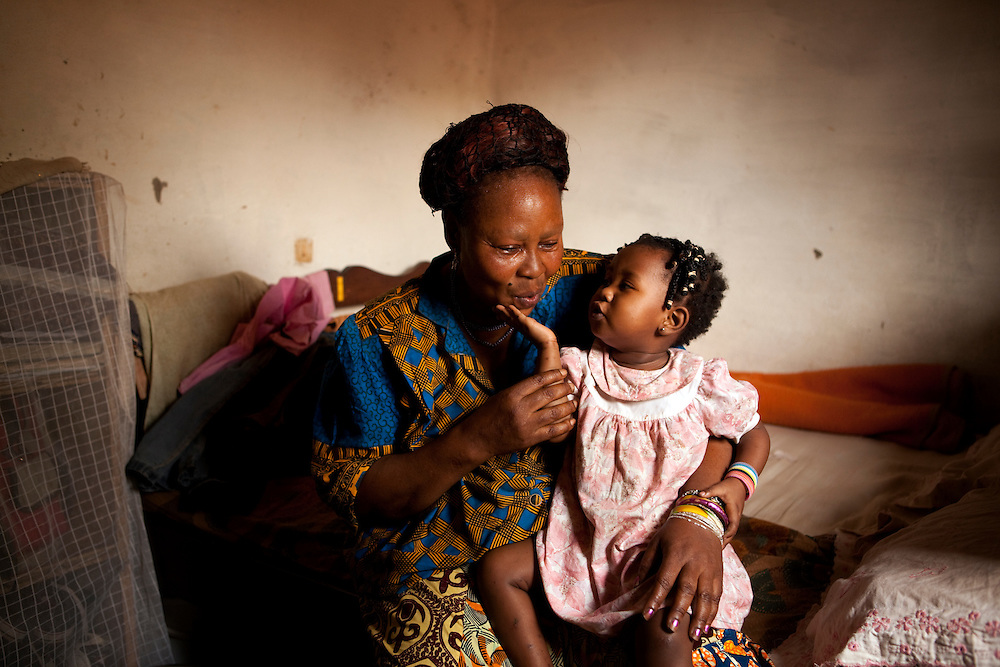 CASE. Chamberline Tchakonte with her granddaughter, Carriere, Yaounde, Cameroon. Chamberline was one of the first people in her community to use solar water disinfection - shortened to SODIS - to treat the water. She is great fan of it and says she has had no stomach problems since starting to use the technique. The technique was introduced by local organization Aquacare. The technique was developed by the Swiss institute Eawag (Swiss Federal Institute of Aquatic Sciences and Technology). They support Aquacare.