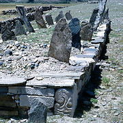 Late Summer? 1965<br /> Long line of Muslim graves in a plot surrounded by a wall inset with decorated marbles from earlier Muslim and Hindu structures.