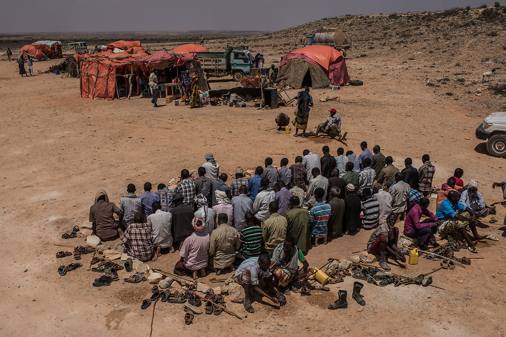 Men pray at an IDP camp on February 24, 2017 in Karin Sarmayo, Somalia. Brief rains brought an estimated 100,000 people to the region in search of land for their livestock, but very limited pasture has lead to mass animal deaths and a growing number of IDP camps.
