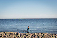 ACCIAROLI (POLLICA), ITALY - 5 OCTOBER 2016: 76-years-old Enzo Speranza does his daily exercise in the sea in Acciaroli, a hamlet in the municipality of Pollica, Italy, on October 5th 2016. Mr Speranza, who lives in Vallo della Lucania (about 30 kilometers from Acciaroli) spends 3 months a year in Acciaroli because of its fresh air and healthy lifestyle. He comes to the beach every day.<br /> <br /> To understand how people can live longer throughout the world, researchers at University of California, San Diego School of Medicine have teamed up with colleagues at University of Rome La Sapienza to study a group of 300 citizens, all over 100 years old, living in Acciaroli (Pollica), a remote Italian village nestled between the ocean and mountains in Cilento, southern Italy.<br /> <br /> About 1-in-60 of the area's inhabitants are older than 90, according to the researchers. Such a concentration rivals that of other so-called blue zones, like Sardinia and Okinawa, which have unusually large percentages of very old people. In the 2010 census, about 1-in-163 Americans were 90 or older.