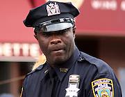 Auxiliary cop at a local street fair.