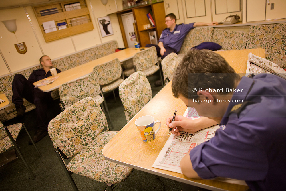 Royal Navy crew rest in the Junior Ratings wardroom aboard HMS Vigilant, a Vanguard class nuclear submarine