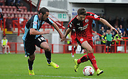 Gwion Edwards trying to break through Wycombe's defence during the Sky Bet League 2 match between Crawley Town and Wycombe Wanderers at the Checkatrade.com Stadium, Crawley, England on 29 August 2015. Photo by Michael Hulf.