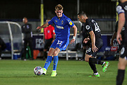 AFC Wimbledon Jack Rudoni (12) taking on Brighton and Hove Albion midfielder Andrew Crofts (48) during the EFL Trophy (Leasing.com) match between AFC Wimbledon and U23 Brighton and Hove Albion at the Cherry Red Records Stadium, Kingston, England on 3 September 2019.