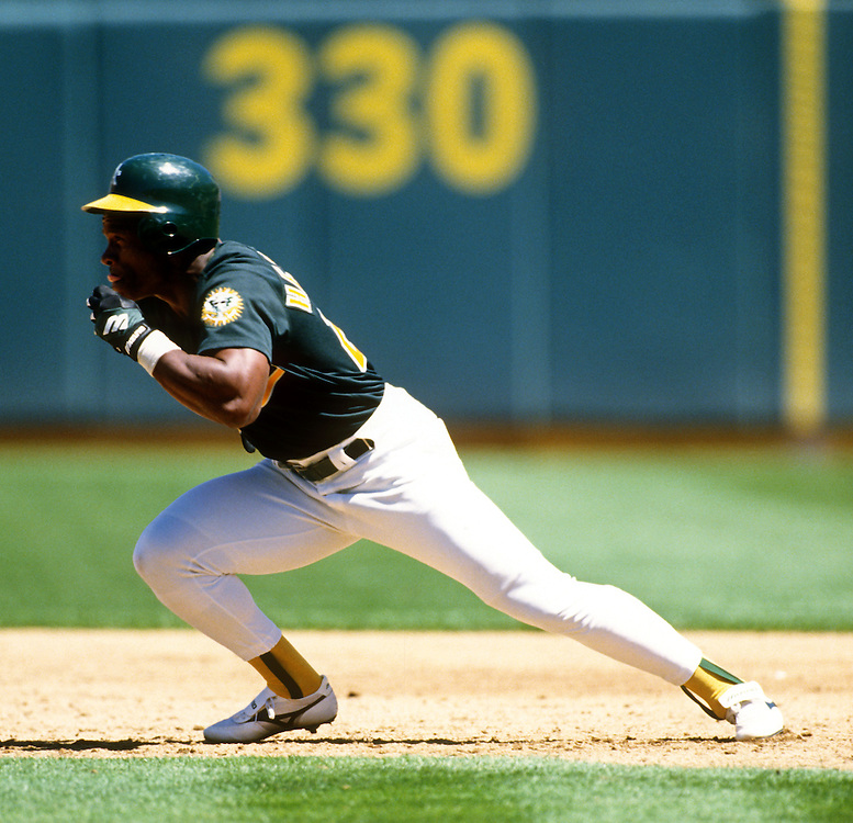 OAKLAND - UNDATED:  Baseball Hall of Fame player Ricky Henderson of the Oakland Athletics runs the bases during a game at the Oakland Coliseum.  Henderson played for the Athletics from 1979-1984, 1989-1993 and1998.  (Photo by Ron Vesely)