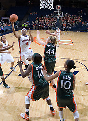 Virginia Cavaliers Center Siedah Williams (4) shoots around the Miami defense.  The University of Virginia Cavaliers defeated the Miami Hurricanes Women's Basketball Team 73-60 at the John Paul Jones Arena in Charlottesville, VA on February 4, 2007.