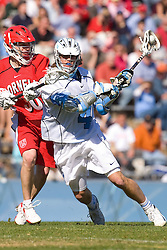 02 March 2008: North Carolina Tar Heels attackman Billy Bitter (4) and Cornell attackman George Calvert (30) during a 13-8 win over the Cornell Big Red on Fetzer Field in Chapel Hill, NC.