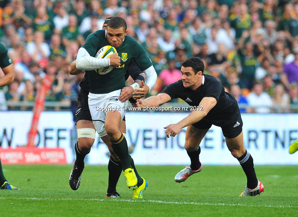 Bryan Habana of South Africa gets away from Daniel Carter of New Zealand and Liam Messam of New Zealand during the 2012 Castle Rugby Championship on the 6 October 2012 at Soccer City in Johannesburg ©Chris Ricco/BackpagePix