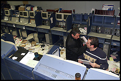.TTP11/AP/28/4/LIFFE CLOSES /DIG .PIC BY ANDREW PARSONS LIFFE, LONDON. THE DISMANTLE OF THE BEAR PIT AS IT CLOSED TODAY ..STAFF FROM LIFFE  FINISH THINGS OFF BEFORE THEY LEAVE Bankers from Liffe surrounded by papers carrying on working as the bear pit is dismantled as Liffe closes in the City of London, April 2000. Photo By Andrew Parsons/i-ImagesCity traders and Bankers from Liffe surrounded by papers carrying on working as the bear pit is dismantled as Liffe closes in the City of London, April 2000. Photo By Andrew Parsons/i-Images