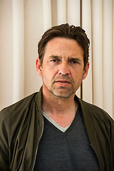 Pictured: Dougray Scott <br /> <br /> Dougray Scott was in Edinburgh to carry out his duties as a member of the Edinburgh International Film Festival jury and to promote his new film, The ReZort. He was joined by Director Steve Barker taking some time out before viewing another film as a Jury member.<br /> <br /> Film synopsis: Following a near apocalyptic zombie outbreak, humans now have the upper hand and life has returned to relative normality with only an occasional reminder or mention of recent horrific events. Most people wouldn&rsquo;t even blink at seeing a zombie now. They know how to handle them. It&rsquo;s no big deal because humans fought and won the battle and are in control again. The latest craze in this post zombie-outbreak world is the Zombie Safari: it is the newest and coolest thing in adventure holidays &ndash; a chance to go out and shoot the undead in the wild. The ultimate test in action and adventure, the ultimate blood sport and, to many, the ultimate in therapeutic revenge. But unbeknownst to most that go on Zafari, the park is a highly controlled and monitored environment; a maze of concealed security cameras, restraints and barriers. The eyes and ears of trained security personnel are on the guests - and the zombies 24/7, always ensuring a safe shooting distance between the living and the undead. Nothing is left to chance.Nothing is unplanned. So<br /> <br /> Ger Harley | EEm Date