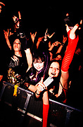 "Nu Metal ""Cradle Of Filth"" fans show their devil horn signals behind barrier, UK, 2000s."