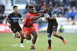 Aled Brew of Bath Rugby fends Josua Tuisova of Toulon - Mandatory byline: Patrick Khachfe/JMP - 07966 386802 - 09/12/2017 - RUGBY UNION - Stade Mayol - Toulon, France - Toulon v Bath Rugby - European Rugby Champions Cup