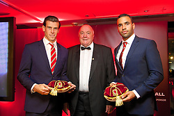 CARDIFF, WALES - Monday, October 6, 2014: Wales' FAW President Trefor Lloyd-Hughes presents caps to Gareth Bale and Hal Robson-Kanu at the FAW Footballer of the Year Awards 2014 held at the St. David's Hotel. (Pic by David Rawcliffe/Propaganda)