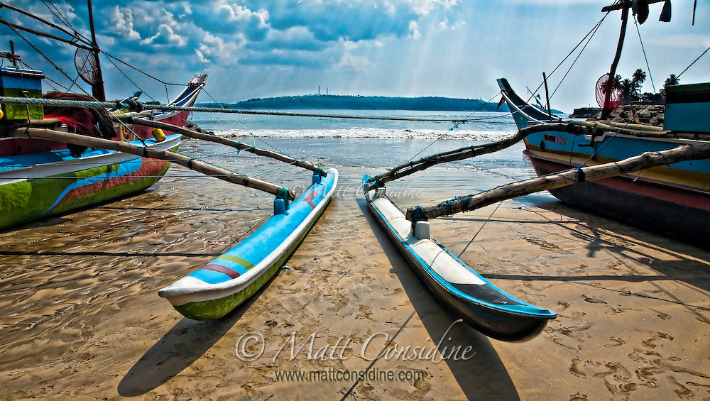 Colorful outriggers on the sand, Sri Lanka.<br /> (Photo by Matt Considine - Images of Asia Collection)