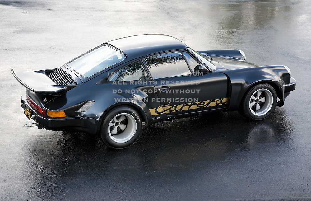 Image of a black sports car hot rod coupe in California, 1974 Porsche 911 RSR Carrera Replica, American Southwest, property released