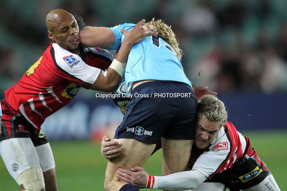 Lionel Mapoe tries to take Ryan Cross but is injuried. NSW Waratahs v Lions. Investec Super Rugby Round 14 Match, 21 May 2011. Sydney Football Stadium, Australia. Photo: Clay Cross / photosport.co.nz