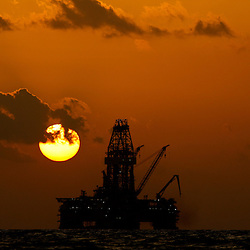 The Transocean Development Driller II leased by BP Plc is seen at sunset as it works to drill a backup relief well at the BP Plc Macondo well site in the Gulf of Mexico off the coast of Louisiana, U.S., on Thursday, July 29, 2010. BP Plc continues to work on a relief well to permanently plug the source of the largest oil spill in U.S. history.  Photographer: Derick E. Hingle/Bloomberg
