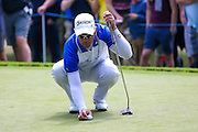 South African golf professional Jaco Van Zyl lines up his putt during the BMW PGA Championship at the Wentworth Club, Virginia Water, United Kingdom on 28 May 2016. Photo by Simon Davies.