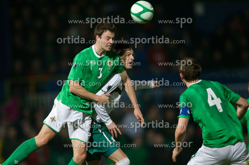 Jonathan Evans of Northern Ireland vs Milivoje Novakovic of Slovenia during EURO 2012 Quaifications game between National teams of Slovenia and Northern Ireland, on March 29, 2011, in Windsor Park Stadium, Belfast, Northern Ireland, United Kingdom. (Photo by Vid Ponikvar / Sportida)