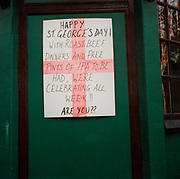 Sign on the outside of a pub advertising Roast beef dinners and free pints to celebrate St George's day.