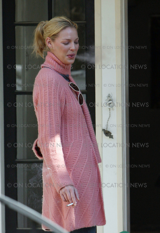 LOS ANGELES, CALIFORNIA - Thursday 24th January 2008. NON EXCLUSIVE: Katherine Heigl visits her new home to oversee her remodeling project. Heigl chatted to contractors and designers while smoking a cigarette on her front porch. Photograph: David Buchan/On Location News. Sales: Eric Ford 1/818-613-3955 info@OnLocationNews.com