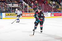 KELOWNA, CANADA - NOVEMBER 23: D-Jay Jerome #12 of the Victoria Royals skates against Liam Kindree #26 of the Kelowna Rockets  on November 23, 2018 at Prospera Place in Kelowna, British Columbia, Canada.  (Photo by Marissa Baecker/Shoot the Breeze)