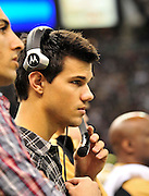 Twilight series ACTOR TAYLOR LATUNER  wears a headset and listens as the plays are being called on the New Orleans Sainst sidelines during the game against the St. Louis Rams. LAUTNER and poses with Saints owner Rita Benson Leblanc  prior to the kick off against the St. Louis Ram.The New Orleans Saints play the St. Louis rams in New Orleans at the Super Dome Sunday Dec. 12,2010. Saints won 31-13.Photo©SuziAltman. New Orleans, Louisiana, U.S. - Twilight Actor TAYLOR LAUTNER hangs out on the Saints sidelines prior to the kick off against the St. Louis Ram.The New Orleans Saints play the St. Louis rams in New Orleans at the Super Dome Sunday Dec. 12,2010. Saints went on to win 31-13..(Credit Image: © Suzi Singer and actress MILEY CYRUS poses for a fan's camera phone with New Orleans police officers on the sidelines prior to The New Orleans Saints' kickoff against the St. Louis Rams at the Superdome. Cyrus is currently filming ''So Undercover'' in New Orleans.Photo©Suzi Altman Twilight series ACTOR TAYLOR LAUTNER  wears a headset and listens as the plays are being called on the New Orleans Sainst sidelines during the game against the St. Louis Rams. LAUTNER and poses with Saints owner Rita Benson Leblanc  prior to the kick off against the St. Louis Ram.The New Orleans Saints play the St. Louis rams in New Orleans at the Super Dome Sunday Dec. 12,2010. Saints won 31-13.Photo©SuziAltman. New Orleans, Louisiana, U.S. - Twilight Actor TAYLOR LAUTNER hangs out on the Saints sidelines prior to the kick off against the St. Louis Ram.The New Orleans Saints play the St. Louis rams in New Orleans at the Super Dome Sunday Dec. 12,2010. Saints went on to win 31-13..(Credit Image: © Suzi Singer and actress MILEY CYRUS poses for a fan's camera phone with New Orleans police officers on the sidelines prior to The New Orleans Saints' kickoff against the St. Louis Rams at the Superdome. Cyrus is currently filming ''So Undercover'' in New Orleans.Photo©Suzi Altman