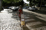 "One of the street animators carrying her mobile library. ""Jazz ao Centro"" jazz festival is held twice a year in portuguese town of Coimbra."