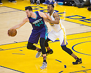Golden State Warriors forward Andre Iguodala (9) defends Charlotte Hornets center Frank Kaminsky III (44) at Oracle Arena in Oakland, Calif., on February 1, 2017. (Stan Olszewski/Special to S.F. Examiner)