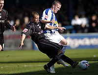 Photo: Olly Greenwood.<br />Colchester United v Brentford. Coca Cola League 1. 01/04/2006. Brentfords Jamie Smith tackles Colchesters Billy Clarke