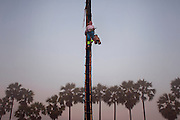 Ko Aung Myo climbing a palm tree to extract the sap, used to make products such as sugar or wine. At Ka Myaw Gyi village in the outskirts of Dawei, Myanmar.