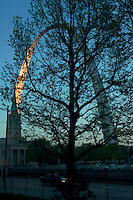 Car Passing by the Gateway Arch at Sunset, Saint Louis, Missouri