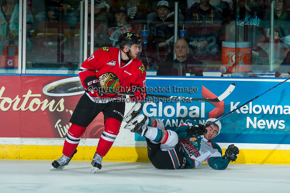 KELOWNA, CANADA - APRIL 7: Alex Overhardt #17 of the Portland Winterhawks checks Dillon Dube #19 of the Kelowna Rockets on April 7, 2017 at Prospera Place in Kelowna, British Columbia, Canada.  (Photo by Marissa Baecker/Shoot the Breeze)  *** Local Caption ***